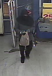 Suspect wanted for robbery to a business
