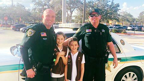 Two deputies get Cookies from Girl Scouts